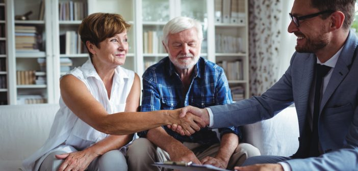 older couple talking to financial advisor