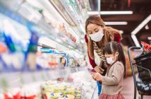 mom and daughter in masks at grocery store