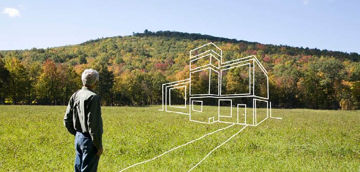 Man on a grass with building outline