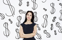 woman in front of dollar signs